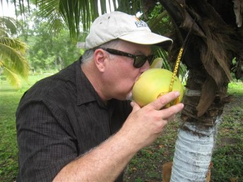 Arizona Expat cooling off with fresh coconut water in Belize