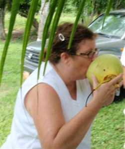 Drinking fresh coconut water in Belize